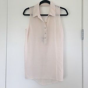 Cream sleeveless top with gold buttons