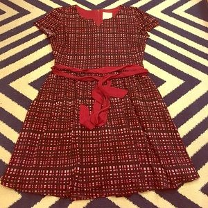 Maroon, red, and light 3/4 length dress.