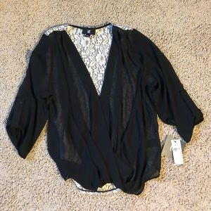 Ladies Black Blouse with Lace back.