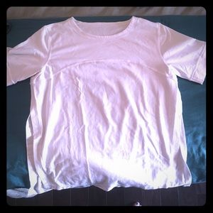 Three quarter sleeve work out top with side slits