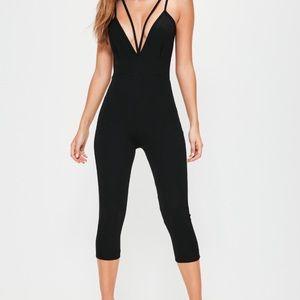 Black harness plunge jumpsuit