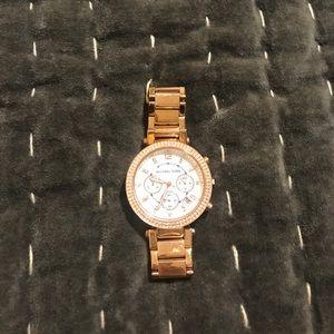 Woman's MK rose gold watch
