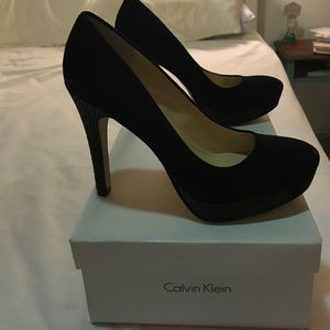Calvin Klein heels with snakeskin detailing.