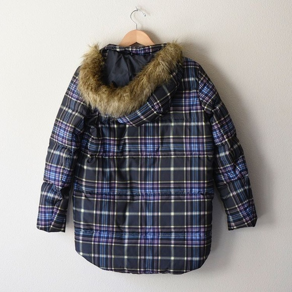 Warm plaid jacket is a winter wardrobe essential Ashley brand junior's jacket features plaid fabrication with Lurex accents Bomber-style jacket features fur-trimmed hood.