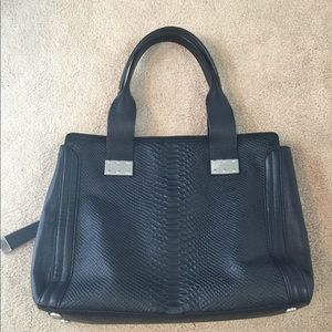 Foley and Corinna black snake embossed tote