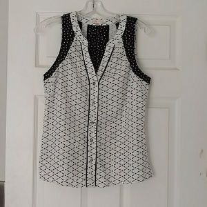 Black and white button down sleeveless top