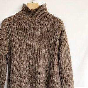 Oversized funnel turtleneck sweater