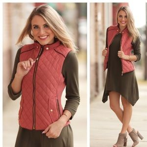 Very cool Quilted Vest size small and large avail