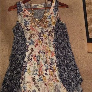 Boutique sleeveless floral top size s