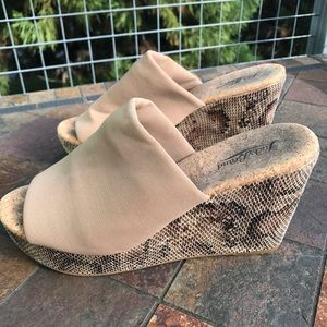 Snakeskin platform wedge sandals.