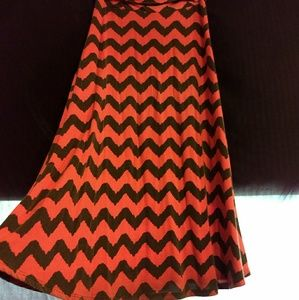Floor length patterned red and black skirt