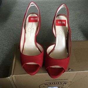 Red open toe pumps.
