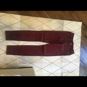 Wax coated burgundy jeans