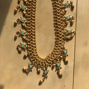 Gold choker necklace with turquoise heart beads.