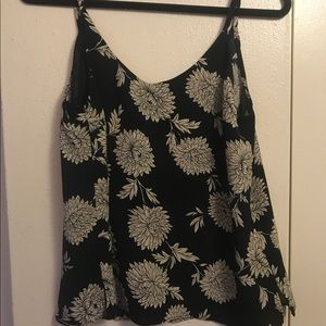 Flowy black tank top with a white floral design