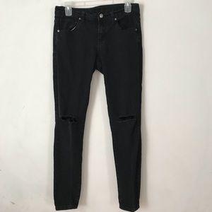 Black skinny jeans (knee slits)