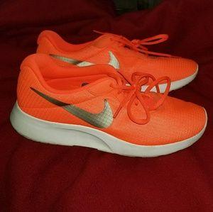 Bright orange Nikes