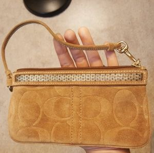 New! Authentic Coach wristlet. Embossed tan suede
