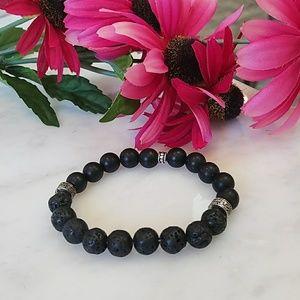 Jewelry - Black beaded lava stone stretch bracelet.