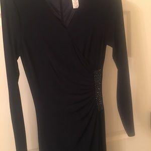 Long sleeve floor length dress, navy blue. Vneck.