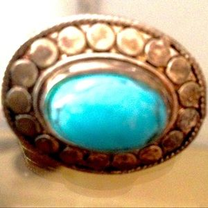 Amazing ring with blue stone.