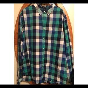 Plaid button up shirt.