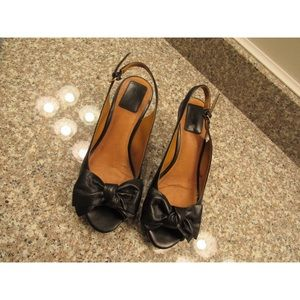 Clarks black leather bow heels