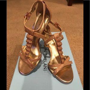 Beautiful dressy heels. Rose gold color.