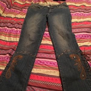 Retro jeans with embroidery on bottom with lacing.