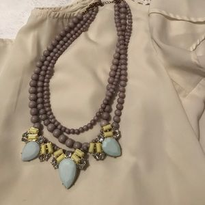 Multi strand gray necklace