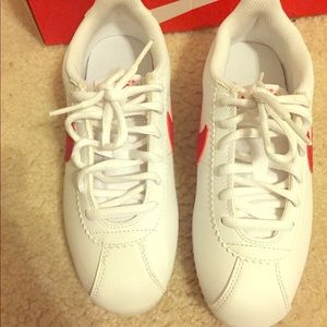 Red and white Nike Cortez