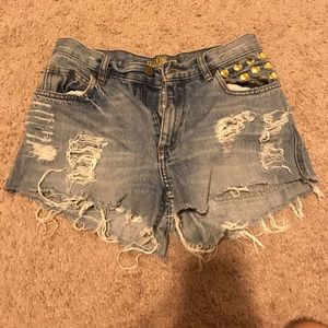 Holey jean shorts with embellishment