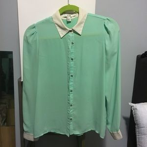 Mint blouse with contract white cuffs