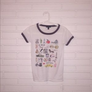 White T-shirt with small pictures on them