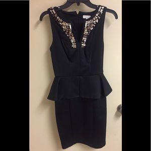 Pretty black peplum dress w/gem adorned front Sz 2