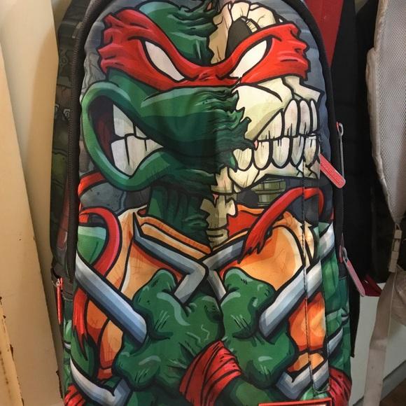 8e2e3f6095c Sprayground TMNT Raphael Skulls Backpack. M_59e99157bf6df5cd3c001372