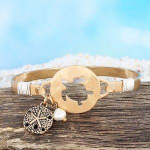 Worn Goldtone Sea Turtle Cut Out Bracelet