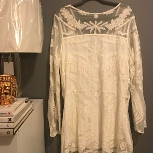 Lace or embroidered white dress