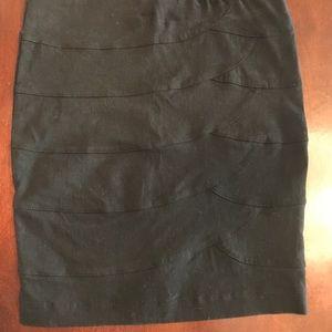Guess XS form fitting black mini skirt