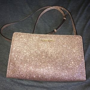 Michael Kors crossbody bag. Rose gold. Used once.