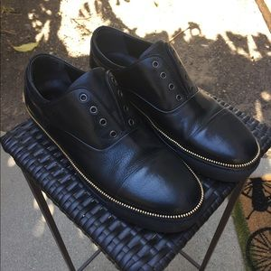 Alexander McQueen black leather shoes