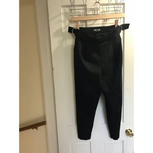 Black trousers with sliver ring buckles