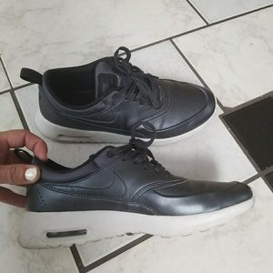 Black metallic Nike premium leather theas