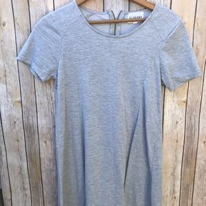 Grey t-shirt dress with zipped back .