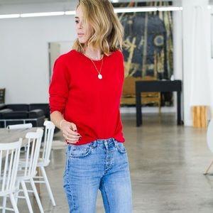 Red women's Gap sweater
