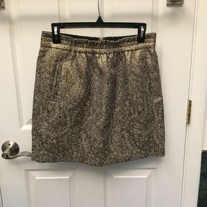 Loft gold mini skirt with packets and lining.