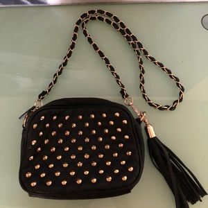 Black cross body bag with gold studs and chain