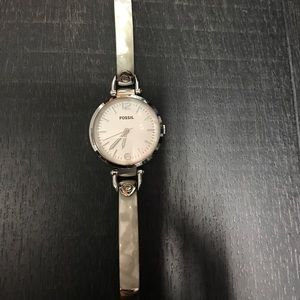 Silver Fossil watch with acrylic band.