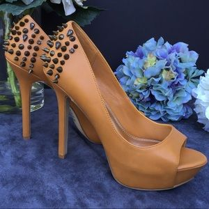 Leather Bakers peek a boo spiked pumps size 9