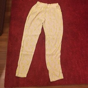 White pants with a bright yellow print